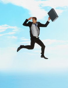 Business man with briefcase jumping in air in search of success